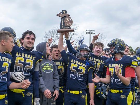The Algonac High School Muskrat football team cheers