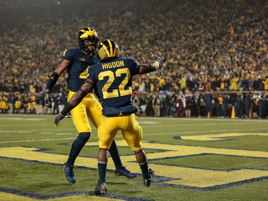 Michigan running back Karan Higdon (22) celebrates