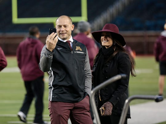 Minnesota head coach P.J. Fleck and his wife Heather