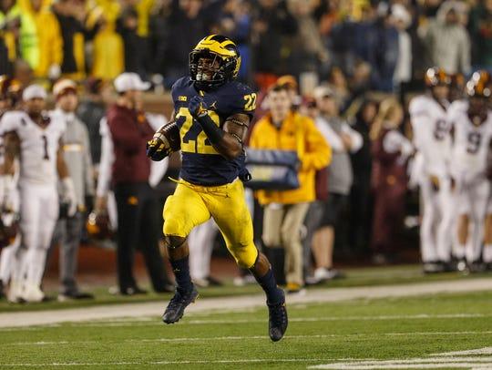 Michigan running back Karan Higdon (22) runs towards
