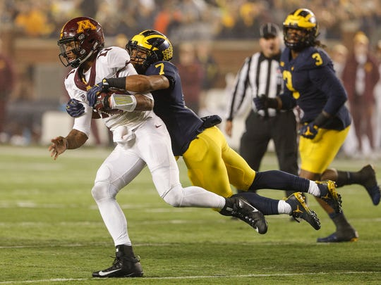 Michigan's Khaleke Hudson sacks Minnesota quarterback