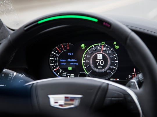 "The semi-autonomous driving system called ""Super Cruise"" is engaged on the highway in the 2018 Cadillac CT6 sedan. Part of the steering wheel turns green along with a light on the dash. The car is traveling on I-75 in Troy on Thursday, November 2, 2017."