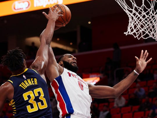 Detroit Pistons center Andre Drummond (0) dunks against Indiana Pacers center Myles Turner (33) in the second half at Little Caesars Arena.