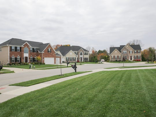 Newer homes with well manicured green lawns in Ryan