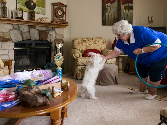 Edna Sasseen gives Princess, a nearly 15-year-old Maltese,