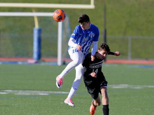 Holmdel's Matthew Leon and Monmouth Regional's Andrew Wallace head the ball during the first half of the Central Group II final between top-seeded Holmdel and second-seeded Monmouth at Holmdel High School in Holmdel, NJ Friday, November 10, 2017.