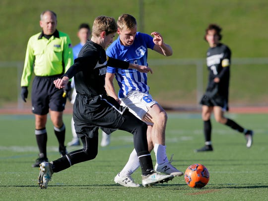 Monmouth Regional's Brian Waltsak and Holmdel's Justin McStay battle for custody of the ball during the first half of the Central Group II final between top-seeded Holmdel and second-seeded Monmouth at Holmdel High School in Holmdel, NJ Friday, November 10, 2017.