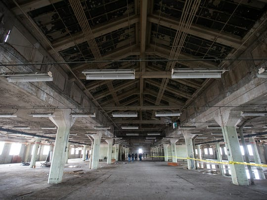 The fourth floor has a high atrium ceiling, made of glass that has been painted over, as seen during a sold-out open house held by Indiana Landmarks at the former Ford manufacturing plant in Indianapolis, Saturday, Nov. 11, 2017. From 1915 to 1932, the plant produced almost 600,000 automobiles. TWG Development now owns the building, which will become a living and retail space.