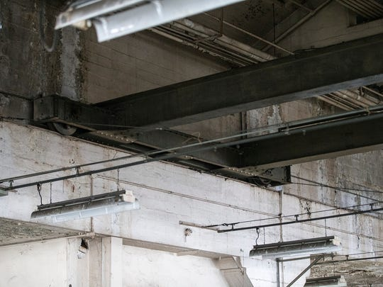 The dark metal beams running horizontally in this photo are a crane that was used to transport materials along the length of the plant, as seen during a sold-out open house held by Indiana Landmarks at the former Ford manufacturing plant in Indianapolis, Saturday, Nov. 11, 2017. From 1915 to 1932, the plant produced almost 600,000 automobiles. TWG Development now owns the building, which will become a living and retail space.