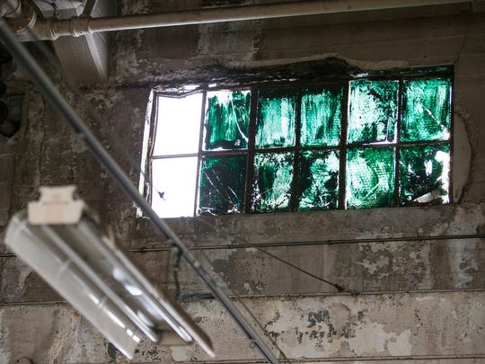 Many of the factory's windows are painted over, as seen during a sold-out open house held by Indiana Landmarks at the former Ford manufacturing plant in Indianapolis, Saturday, Nov. 11, 2017. At one point, 60 percent of the building's exterior was windows. From 1915 to 1932, the plant produced almost 600,000 automobiles. TWG Development now owns the building, which will become a living and retail space.