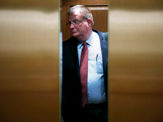 Oregon Health Authority Director Pat Allen stands in an elevator as the doors close in the Oregon Capitol in Salem, Oregon, Monday, Nov. 13, 2017.