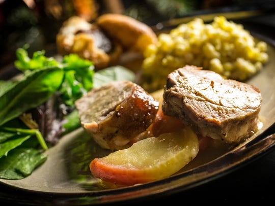 Traditional Indiana foods for your holiday menu including apple cider glazed pork loin with stewed apples, corn pudding and Nashville House fried biscuit with apple butter, Tuesday, Nov. 14, 2017.