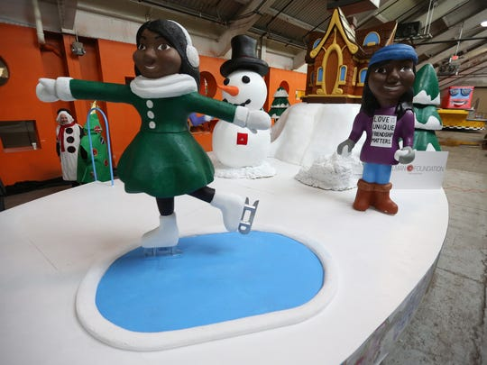 """Yuliana Ortiz, 12, of Detroit is the winner of the 26th Annual Skillman Foundation's Float Design contest for America's Thanksgiving Parade by Art Van for her drawing, """"The Snowing Mountains,"""" at the Parade Company in Detroit on Wednesday, Nov. 15, 2017."""