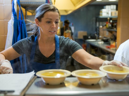 Sarah Cummins helps serve lunch at Dayspring Center