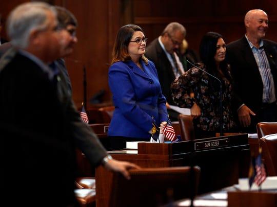 Sen. Sara Gelser, D-Corvallis, stands with the rest