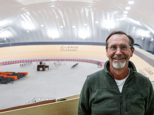 Dale Hughes, executive director of the Detroit Fitness Foundation, stands inside the Lexus Velodrome.