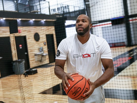 Former Indiana Pacer Fred Jones shoots around at his