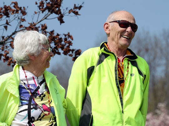 Ann and John Karras of share some laughs as they reflect on the early days of RAGBRAI during the 2011 dedication and ribbon cutting ceremony of the High Trestle Trail in Ankeny just west of the fire station. The 25-mile long bike trail travels through the communities of Ankeny, Sheldahl, Slater, Madrid, and Woodward.
