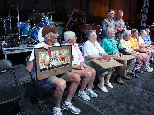 John and Ann Karras helped RAGBRAI celebrate its 40th birthday during a 2012 bash in downtown Cedar Rapids. Eight cyclists who had participated in all 40 RAGBRAIs were recognized on stage. Co-founder Karras, far left, sat with Ann.