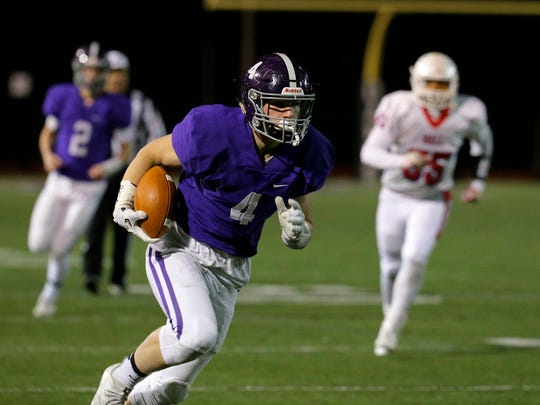 Rumson-Fair Haven's Ian O'Connor catches a pass and runs for a touchdown during the first quarter of the Wall vs. Rumson-Fair Haven NJSIAA Central Group IV semifinal football game at Rumon-Fair Haven High School in Rumson, NJ Friday, November 17, 2017.
