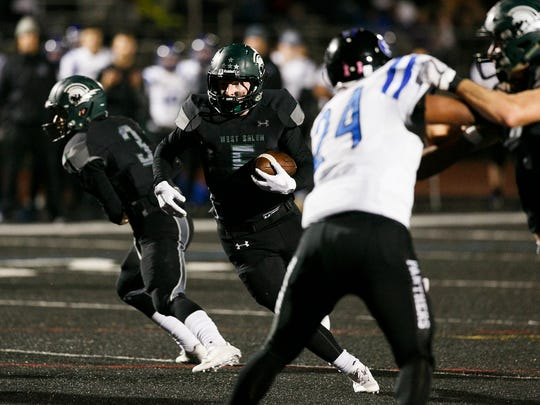 West Salem's Jacob Denning (5) carries the ball in a OSAA 6A quarterfinal game against South Medford on Friday, Nov. 17, 2017, at West Salem High School.
