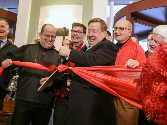 Center, Carmel Mayor James Brainard and others cut the ribbon during the grand opening of the ice skating rink and inaugural Christkindlmarkt at The Center for the Performing Arts in Carmel, Ind., Saturday, Nov. 18, 2017. Due to inclement weather, the first ice skating session and opening of merchant huts were delayed. The German-themed Christmas market is open select days through Christmas Eve, and the skating rink is open various hours Wednesday to Sunday through March 11.