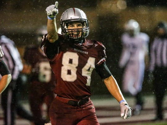Danville's WR Ben Stevens (84) celebrates a touchdown during a game against Memorial High School at Danville on Saturday, Nov. 18, 2017.