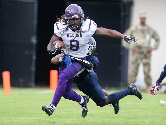 Alcorn running back De'Lance Turner is hauled down