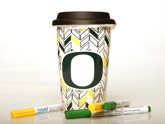 If you are into adult coloring books, you'll love this ceramic travel cup that lets you color in the shapes, $14, with green and yellow paint markers, Oregon Capitol Store, Oregon State Capitol.