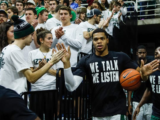 Michigan State's Miles Bridges high-fives fans as he
