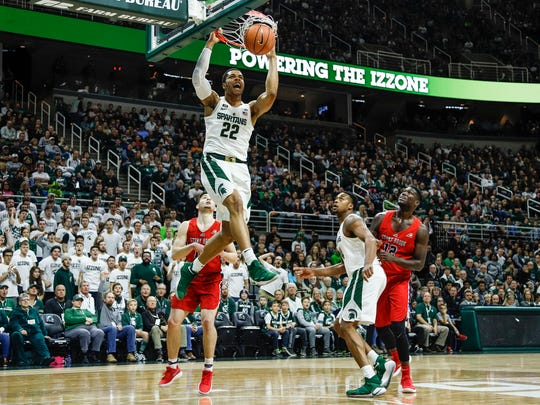 Michigan State's Miles Bridges (22) makes a dunk during the first half on Sunday, Nov. 19, 2017, at Breslin Center.