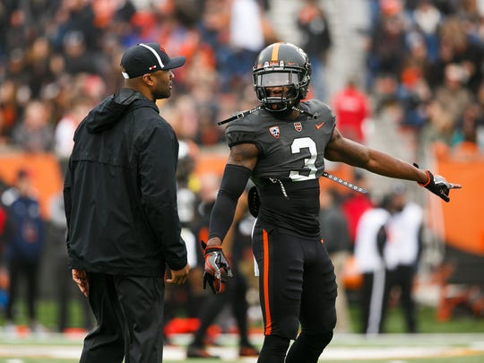 Oregon State's Brandon Arnold (3) talks to interim coach Cory Hall before the game against Arizona State on Saturday, Nov. 18, 2017, at Reser Stadium in Corvallis, Ore. Arizona State won the game 40-24.
