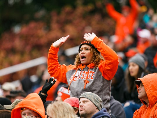 An Oregon State fan cheers during a game against Arizona State on Saturday, Nov. 18, 2017, at Reser Stadium in Corvallis. There has been little to celebrate this season for OSU fans.