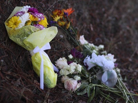 Residents left flowers on the side of Stagecoach Road in Rancho Tehama Reserve for Michelle McFadyen who was gunned down in a shooting rampage on Nov. 14, 2017. Her husband, Troy McFadyen, survived the shooting.