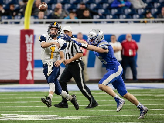 Ottawa Lake Whiteford quarterback Thomas Eitniear (1) makes a pass during the first half of the MHSAA Division 8 championship game against Saginaw Nouvel at the Ford Field in Detroit, Friday, November 24, 2017.