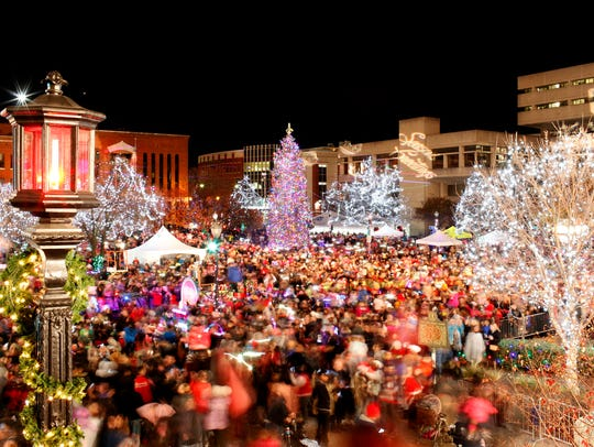 Jefferson Square is illuminated with lights as the
