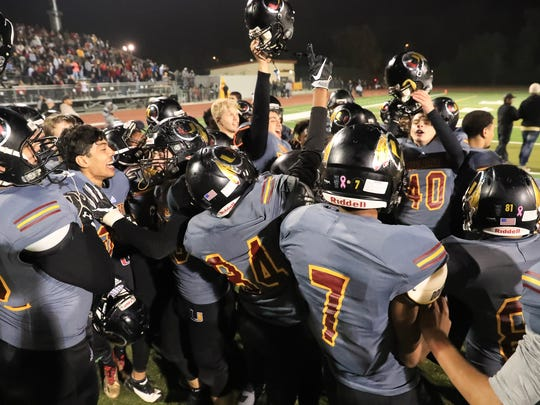 Tulare Union celebrates winning the Central Section Division II Championship high school football game at Bob Mathias Stadium on Nov 24, 2017.