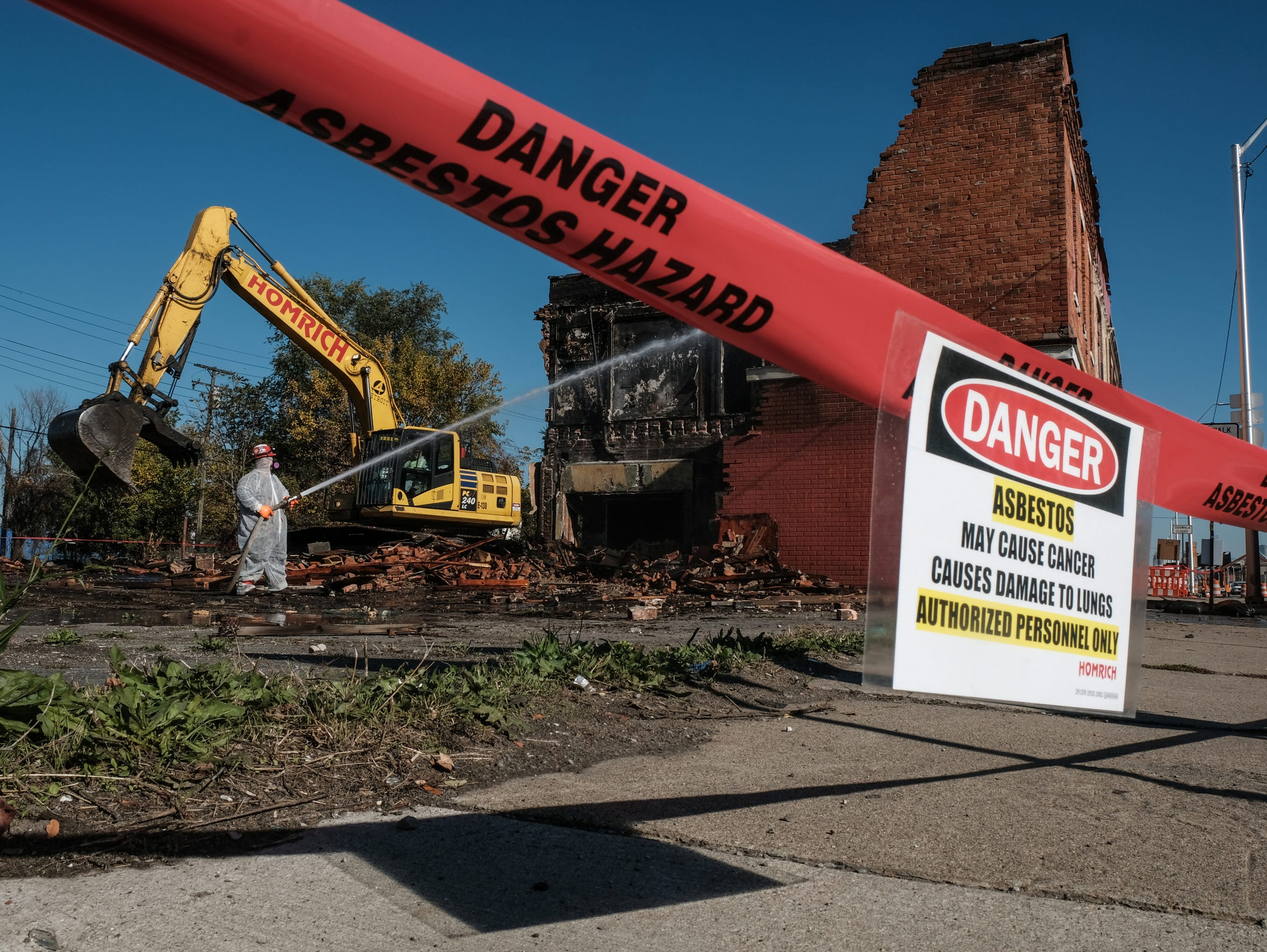 Buildings at the corner of Fort Street and Dragoon in Detroit's Delray neighborhood are torn down on Nov, 8, 2017 to make way for the long-planned new bridge to Canada.