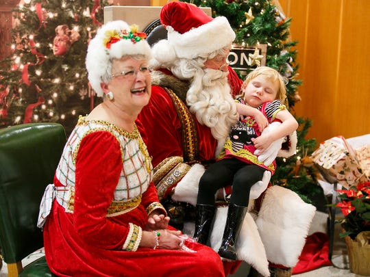 Rylee O'Roke is fast asleep in the arms of Santa Claus at the 36th annual Holidays at the Capitol Tree Lighting Celebration on Nov. 28, 2017.