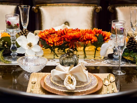 Decorated with seasonal elements, this holiday table setting can easily transition from Thanksgiving to Christmas with a few simple changes.