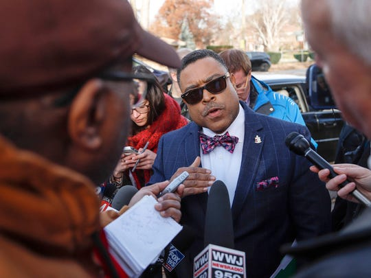 Arnold Reed, attorney for congressman John Conyers,  answers questions from reporters outside the Conyers home in Detroit, Friday, December 1, 2017.