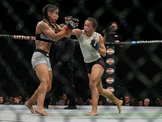 Tecia Torres, left, fights Michelle Waterson during