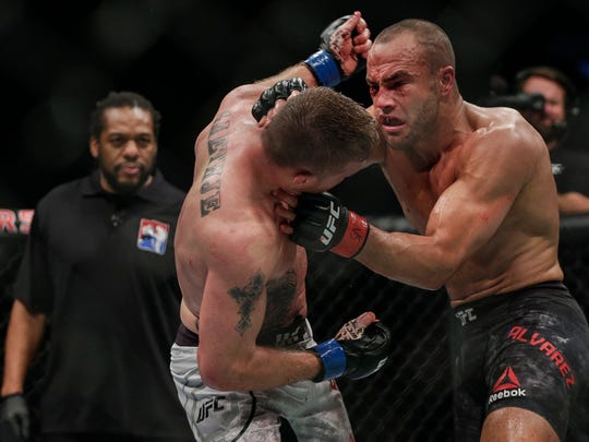 Justin Gaethje, center, fights Eddie Alvarez during
