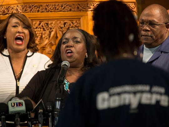 State Rep. Sherry Gay-Dagnogo, D-Detroit, former Detroit city council member JoAnn Watson and Rev. Wendell Anthony make a call  to action as she speaks in support of Congressman John Conyers during a rally  at the Hartford Memorial Baptist Church in Detroit.