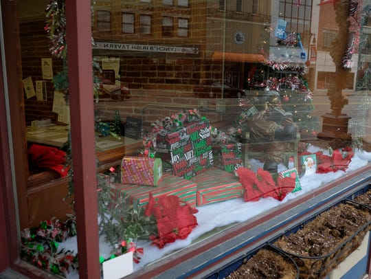 Christmas decorations in the window of ResourceMFG.