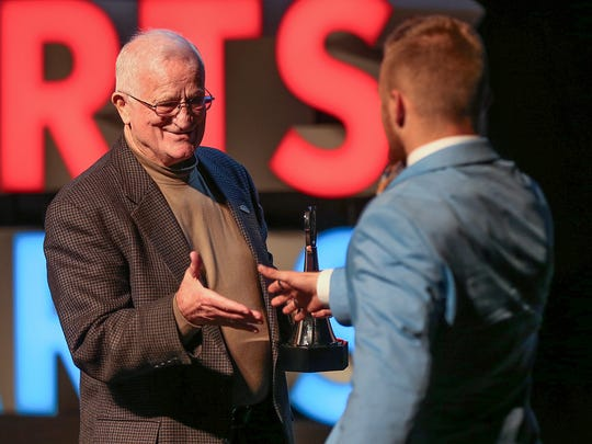 Bobby Plump, 1954 IndyStar Mr. Basketball, presented the Comeback Player of the Year Award to Center Grove's Titus McCoy.