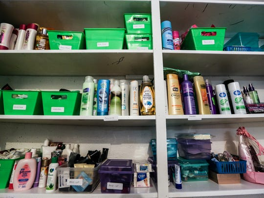 The pantry is filled with donations food and supplies at Sanctum House.