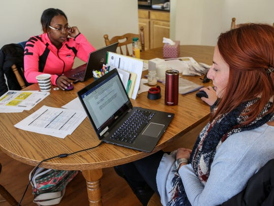 Staff members are at work at Sanctum House, a shelter for survivors of human trafficking.