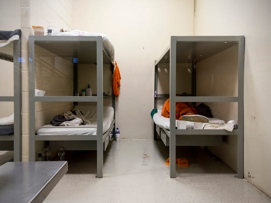 An inmate sleeps on a bed inside of the A Unit of the