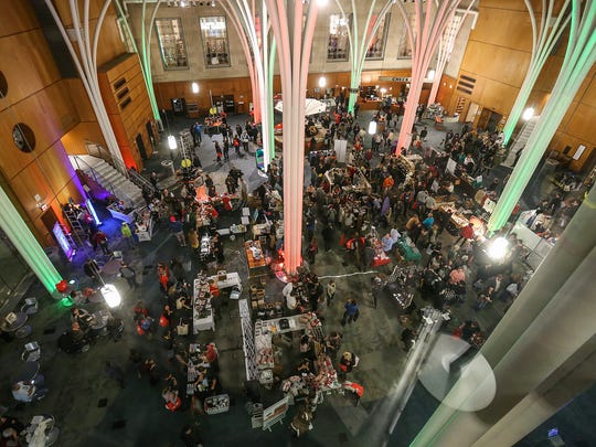 Thousands of shoppers packed every floor of the downtown Indianapolis Central Library during Yelp's Totally Bazaar, Thursday, Dec. 7, 2017. The pop up shopping party featured over 150 local businesses.